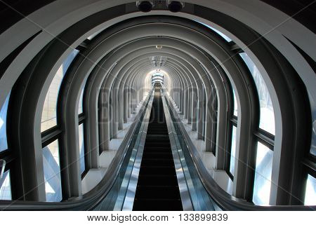 Long and illusional escalator in the skyscraper