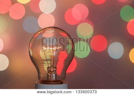Concept light bulb with a light bokeh background design