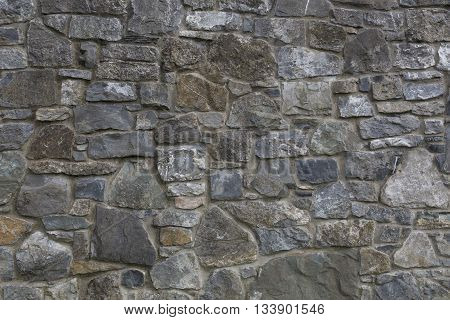 Stone wall, texture background. Different stone size