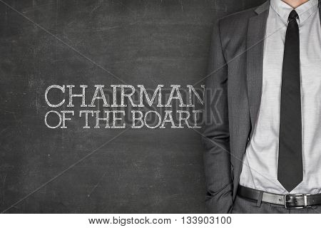 Chairman of the board on blackboard with businessman in a suit on side