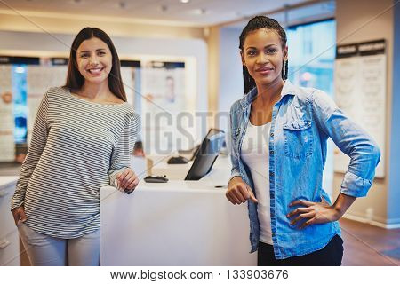 Smiling Diverse Girl Friends Stand Against Counter