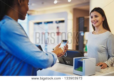 Customer Paying For Order With Phone And Pin Pad