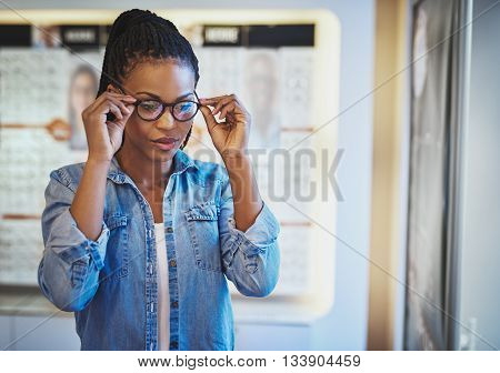 Young Woman Testing The Fit For Eyeglasses