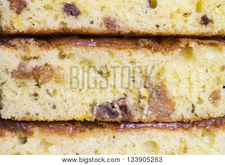 Beautiful bright background from sweet fruit cake with raisins on dessert