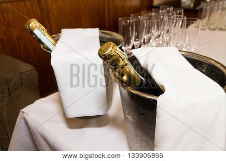 Champagne Bottles And Glasses And Prepared For Toast. Wedding Marriage.