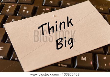 Think big concept on black keyboard background