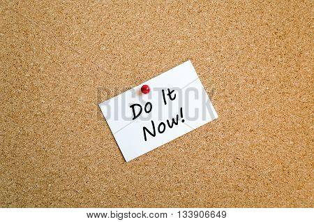 Sticky Note On Cork Board Background And Do It Now Text Concept