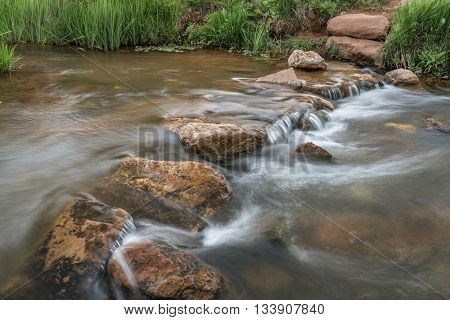 a trail crossing mountain creek with a row of step stones - Red Mountain Open Space, Colorado