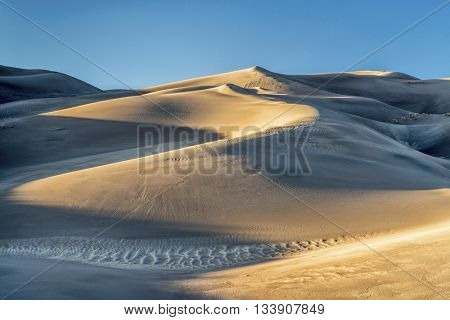 sand dunes patterns at sunset - Great Sand Dunes National Park in Colorado