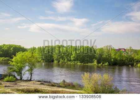 The kind when it's summer and the river was filled with water, and the trees awake from winter and delight the eye with vivid greens