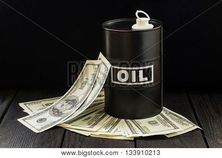 Oil Business Concept. Barrel Of Oil On Dollar Bills