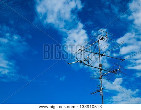 TV antenna with background of blue sky