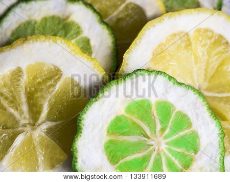 lemons and limes on white background. Green and yellow.