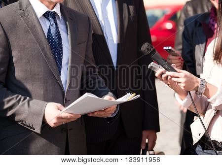 Reporters making media interview with businessperson or politician