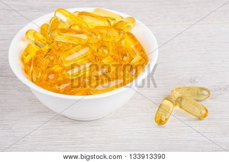 Softgels Fish Oil In Glass Bowl On Table
