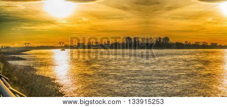 Artistic work of my own. HDR processing. Panoramic romantic sunset over the Rhein.