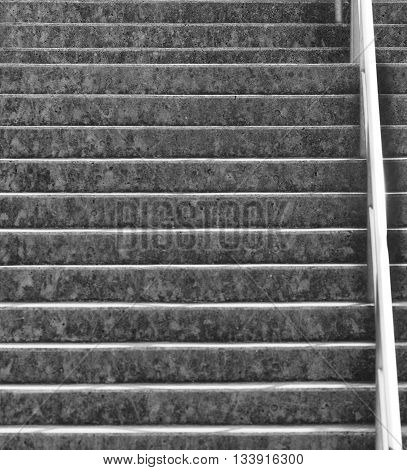Black and white urban concrete stairs and railing