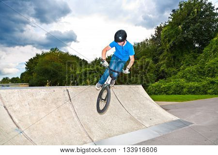 Boy Has Fun With His Bmx At The Skatepark