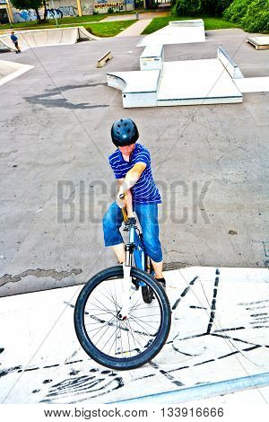 Boy On His Bike At The Skate Park