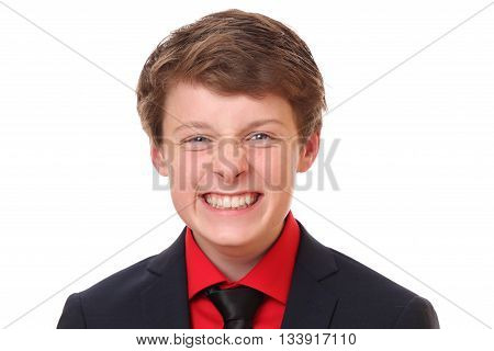 Portrait of a funny teenage boy wearing a suit on white background