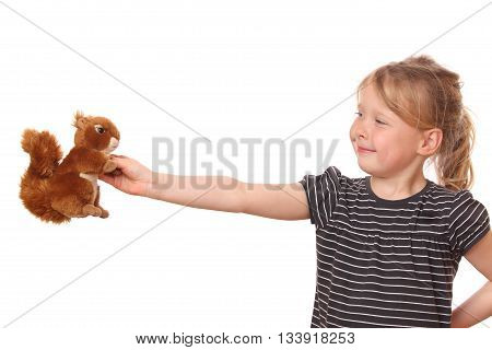 Portrait of a young girl with stuffed animal on white background