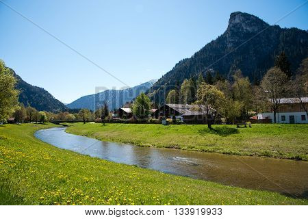 Panoramic View Of Beautiful Landscape In The Alps With Fresh Green Meadows And Blooming Flowers And