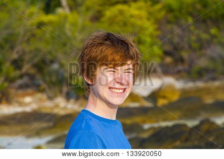 Cute Boy At The Tropical Beach With Funny Face
