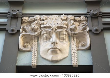 Architectural detail of a bas-relief on the old house on the small street of Riga. Latvia Europe.