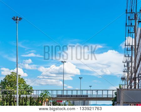 Spotlight pole electric pole and overpass on beautiful sky with cloudy background in the city at north of Thailand Cityscape