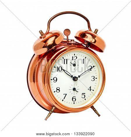 Bronze vintage alarm clock isolated on white background.