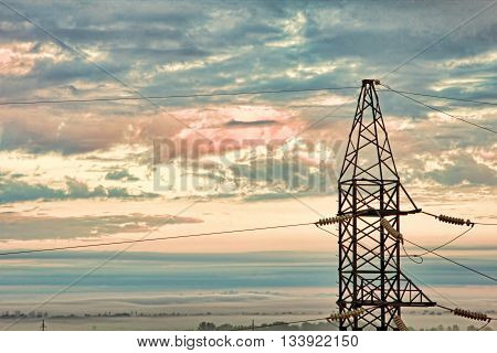 Electricity pylon against of dramatic cloudy sky.Toned image.