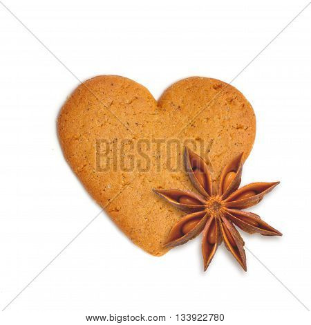 heart shape xmas cake with spice anis isolated on white background
