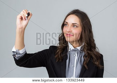 business woman with a holding marker in hand studio picture
