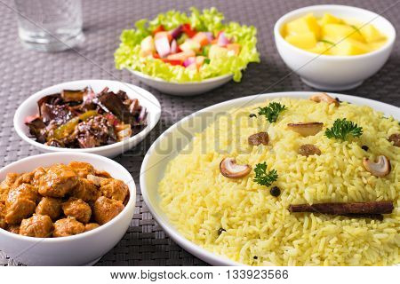 Yellow rice and curry or kaha bath dark background Sri Lankan food