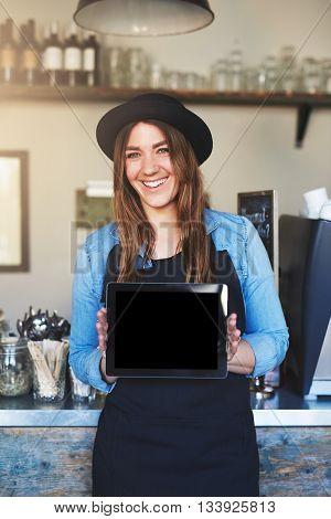 Female Entrepreneur Wearing Black Hat And Apron