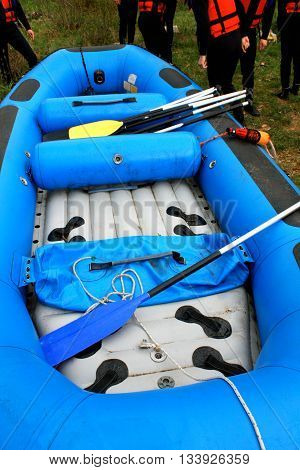 rafting inflatable blue boat wit rafters on side