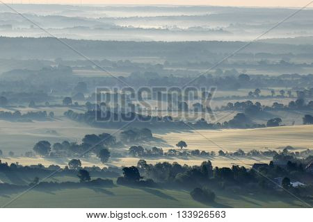 Aerial view of a landscape at sunrise