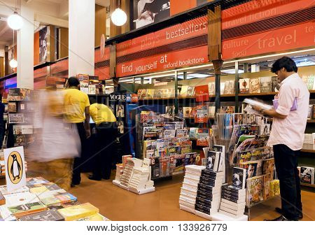KOLKATA, INDIA - JAN 10, 2016: Young people choose the magazines and books inside the popular bookshop on January 10, 2016. From 1976 Kolkata have the Book Fair with 2 million visitors annual