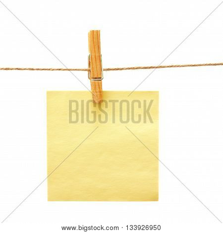 Yellow reminder with clothes peg over white