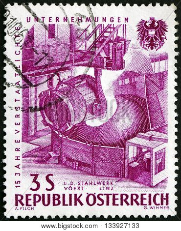 AUSTRIA - CIRCA 1961: a stamp printed in Austria shows Pouring Steel 15th Anniversary of Nationalized Industry circa 1918
