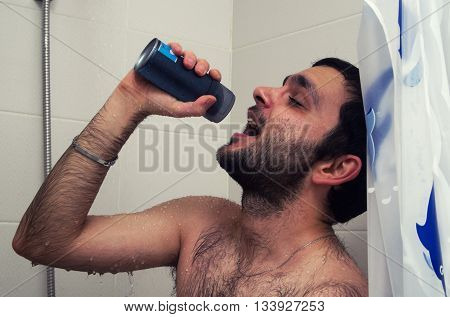 funny man sings in the shower close up