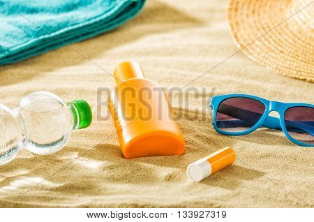 Various beach accessories in the sand on the beach