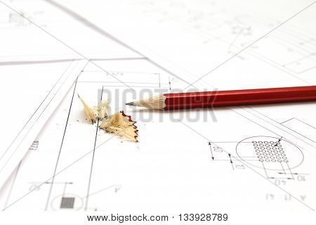 Pencil and blueprints for an architect's design drawings