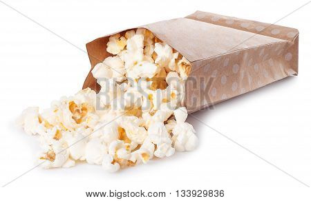 Popcorn in paper bag scattered on white background. Popcorn in paper box isolated on white. Striped box of popcorn isolated on white background
