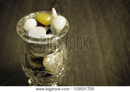 Colorful Semiprecious Stones In A Glass Vase