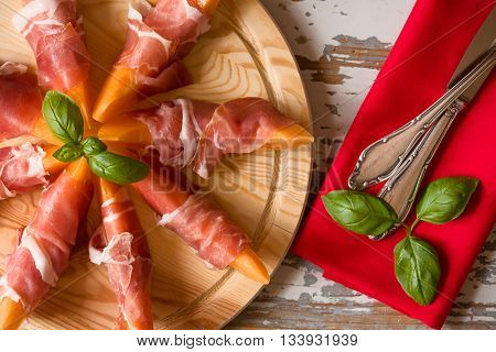 Close up of Italian appetizer with prosciutto and melon