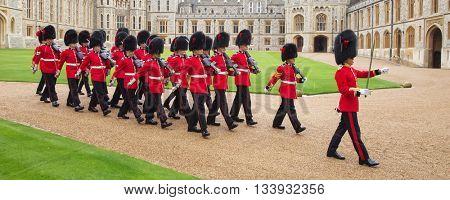 WINDSOR - APRIL 16: Unidentified men members of the royal guard during change ceremony on April 16, 2016 in Windsor, United Kingdom.