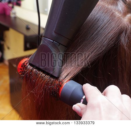 Professional drying hair in a salon closeup