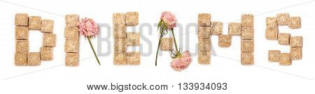Text dream of roses and cane sugar isolated on a white background. Series: Sweet love sweet dreams