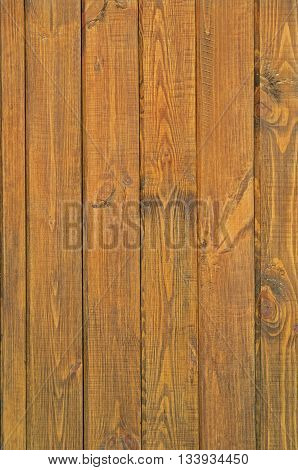 Pine boards treated with wood stain to protect against external influences and wood beetle pests